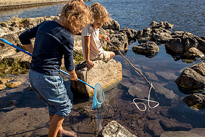 Children playing on the lakefront - p1355m1574072 by Tomasrodriguez