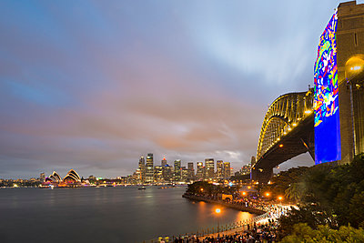 Australia, New South Wales, Sydney, Skyline with Sydney Opera House and Sydney Harbour Bridge in the evening - p300m1579380 by Markus Kapferer
