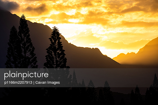 Sunset through the Ko'olau Mountains of Oahu Hawaii - p1166m2207913 by Cavan Images