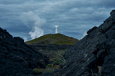 Amazing landscape of lighthouse on mount in stormy day - p1166m2157286 by Cavan Images