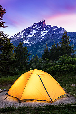 Tent and Teton Range at dusk, Grand Teton National Park; Wyoming, United States of America - p442m1442360 by Yves Marcoux