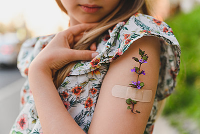 Girl's arm with flower and band-aid - p300m2287563 by Ekaterina Yakunina