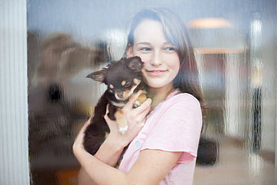 Smiling girl with dog - p312m1470777 by Christina Strehlow