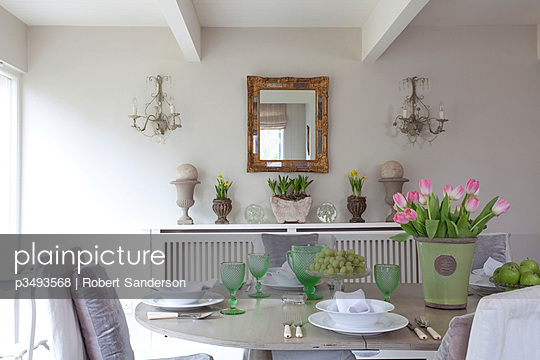 Table with tulips in Sussex dining room  UK - p3493568 by Robert Sanderson