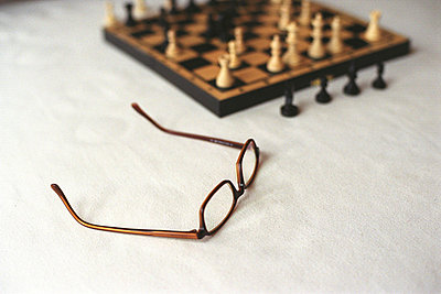 Chess Board and Glasses standing on Table - p4737184f by Stock4B