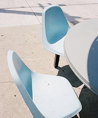 Worn Blue Plastic Chairs - p1431m2247665 by Daniel R. Lopez