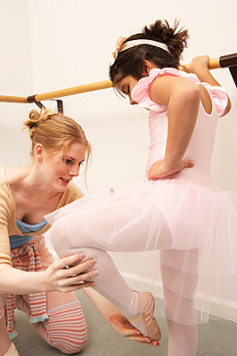 Girl working with ballet teacher - p555m1420373 by Tanya Constantine