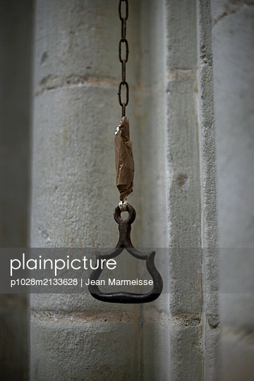 Repaired handle hanging in a church - p1028m2133628 by Jean Marmeisse
