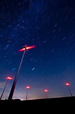 Wind farm at night - p1079m881297 by Ulrich Mertens