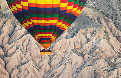 Hot air balloon flying over the Goreme Valley; Cappadocia, Nevsehir, Turkey - p442m1225041 by Peter Langer