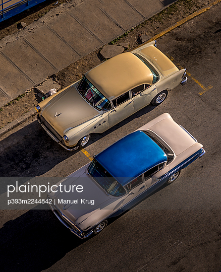 Two classic cars in the town, Cuba - p393m2244842 by Manuel Krug