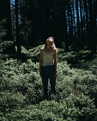 Young woman lost in the forest - p1184m1424532 by brabanski