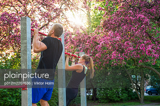 Couple exercising in park - p312m2207636 by Viktor Holm