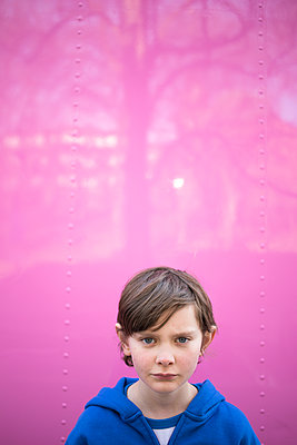 Sweden, Portrait of Boy (12-13) against pink wall - p352m1079361f by Andreas Ulvdell