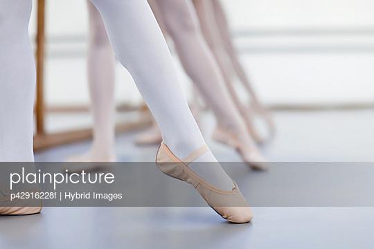 Close up of ballet dancers' feet