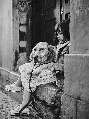 Girl and dog on the street - p1522m2280175 by Almag
