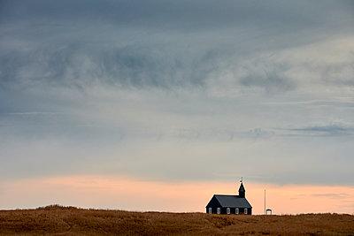 Church building against sunset sky - p1166m2163046 by Cavan Images