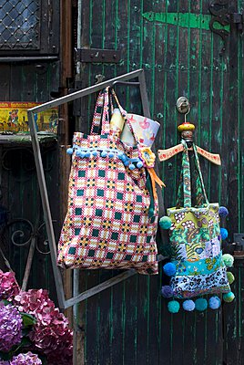 Shopping bags in various patterns decorated with colourful pompoms - p1183m996836 by Manduzio, Matteo