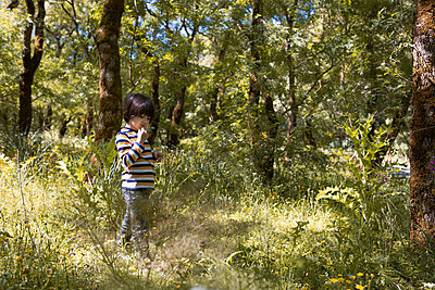 Child in the forest - p1623m2209928 by Donatella Loi