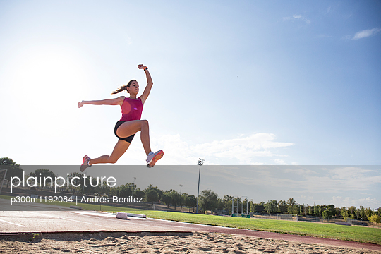 Female long jumper mid-air