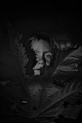 Boy with Large Leaf - p1169m955941 by Tytia Habing