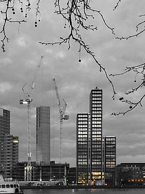 Cranes building a skyscraper - p1048m2016481 by Mark Wagner