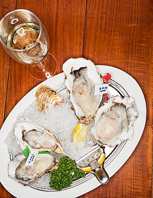 Fresh oysters and white wine - p312m695700 by Susanne Walstrom