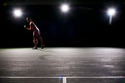Woman playing tennis indoors - p42917784 by Mike Tittel