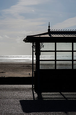 Shelter by the beachfront - p1047m1041666 by Sally Mundy