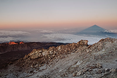Shadow of Mount Teide in the horizon seen from the summit - p1166m2124331 by Cavan Images