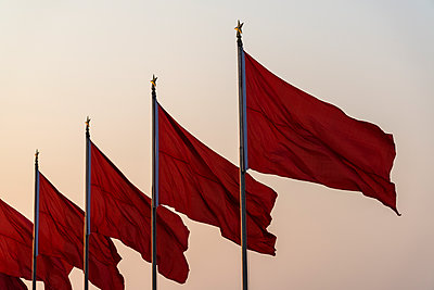 Red flags blowing in the wind - p1170m1441198 by Bjanka Kadic