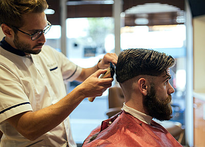 Barber shaving head of a customer - p300m1081362f by Marco Govel