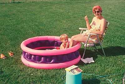 Mother and son together in a wading pool - p30118198f by Jocelyn Michel