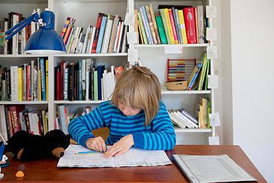 Girl doing homework - p505m2169013 by Iris Wolf