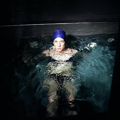 Woman in a pool - p1610m2231164 by myriam tirler