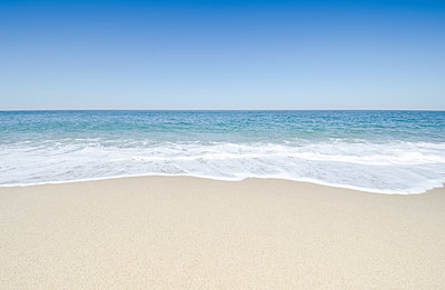 Beach under blue sky - p1427m2186449 by Chris Hackett