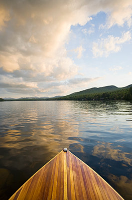 United States, New York, Lake Placid, Wooden boat on Lake Placid at sunset - p1427m2271680 by Chris Hackett