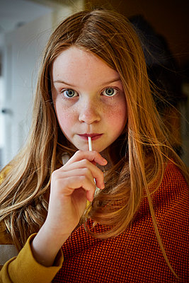 Young girl with Lolliop  - p1612m2223698 by Heidi Coppock-Beard
