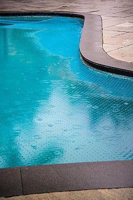 Swimming pool with raindrops - p1170m1090766 by Bjanka Kadic