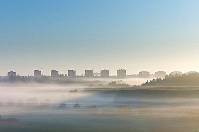 City skyline at sunrise - p575m696083 by Stefan Ortenblad