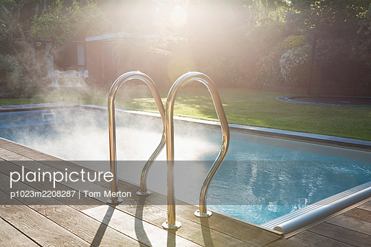 Sunny summer swimming pool - p1023m2208287 by Tom Merton