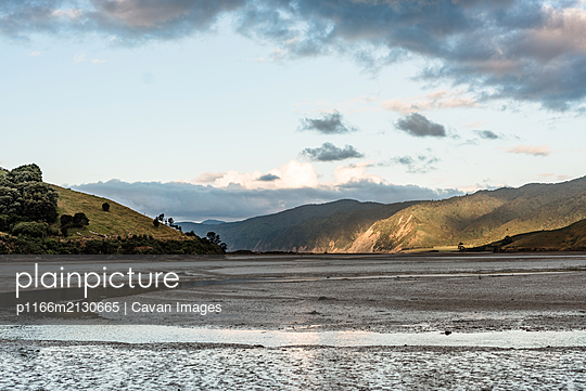 View of an estuary in New Zealand at low tide - p1166m2130665 by Cavan Images
