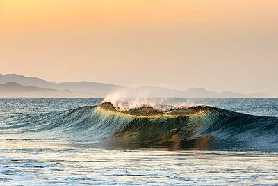 wave breaking near Todos Santos in Baja California, Mexico - p1014m1514153 by Jeff Hornbaker