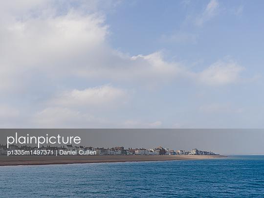 English Coastal Town with pebbe beach - p1335m1497371 by Daniel Cullen