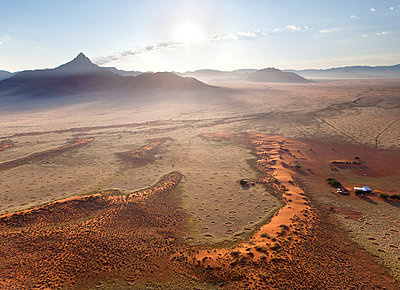 Aerial view from hot air balloon at dawn over magnificent desert landscape of sand dunes, mountains and Fairy Circles, Namib Rand game reserve Namib Naukluft Park - p871m819413 by Lee Frost