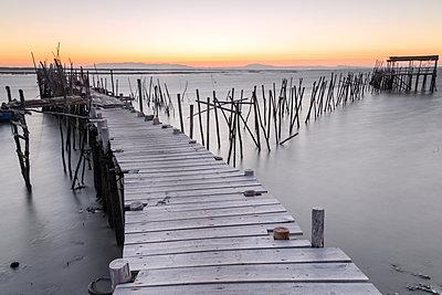 Sunset at Palafito Pier of Carrasqueira, Natural Reserve of Sado River, Alcacer do Sal, Setubal, Portugal, Europe - p871m1174303 by Roberto Moiola