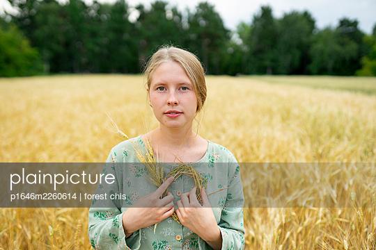 Woman in a cornfield - p1646m2260614 by Slava Chistyakov
