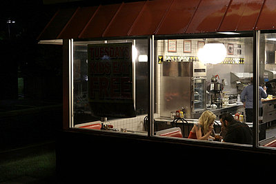 Couple in Diner at Night - p1019m831431 by Stephen Carroll