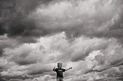 Boy in clouds - p1169m955947 by Tytia Habing
