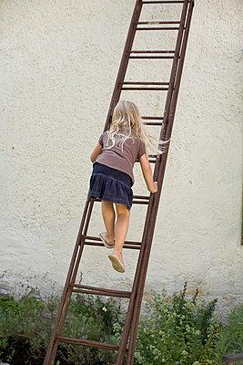 A girl climbing a ladder Gotland Sweden. - p31217989f by Johan Ödmann